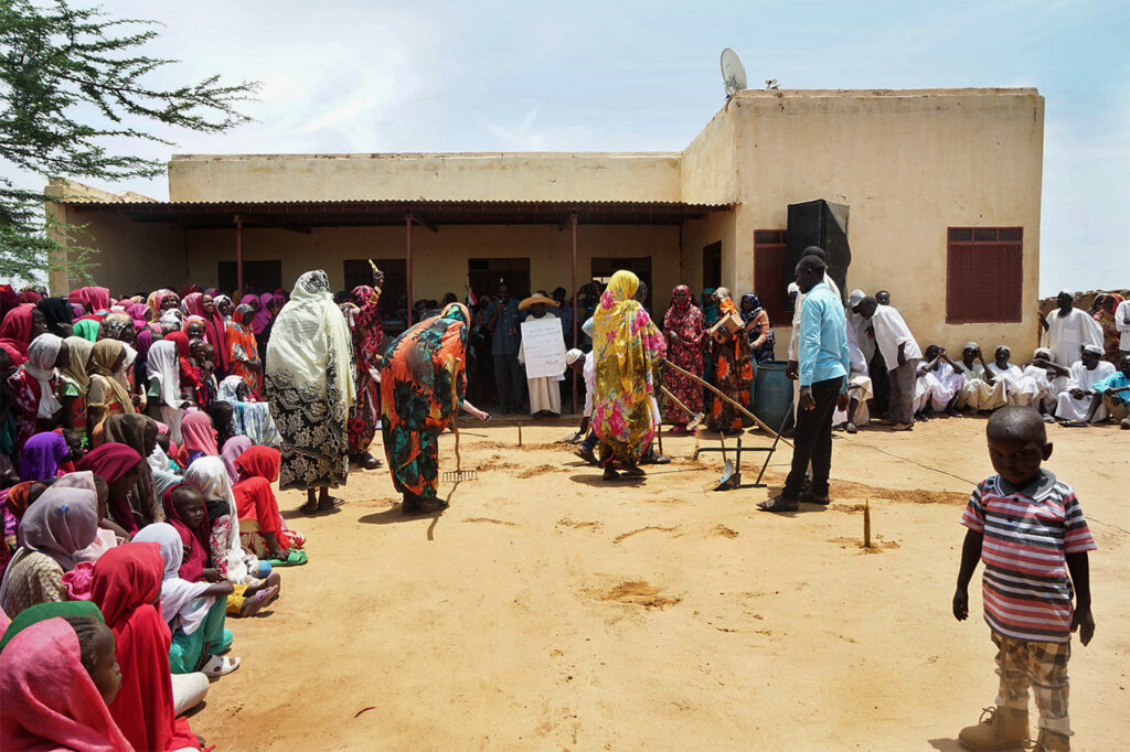 A communitycelebrating the reversal of desertification in the village of Majhoub, Sudan